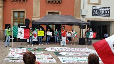 Photo of Con cubrebocas, protestan contra AMLO en el centro de León